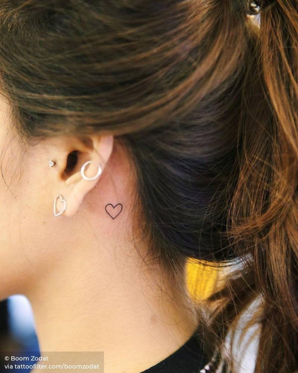Minimalist heart behind the left ear.