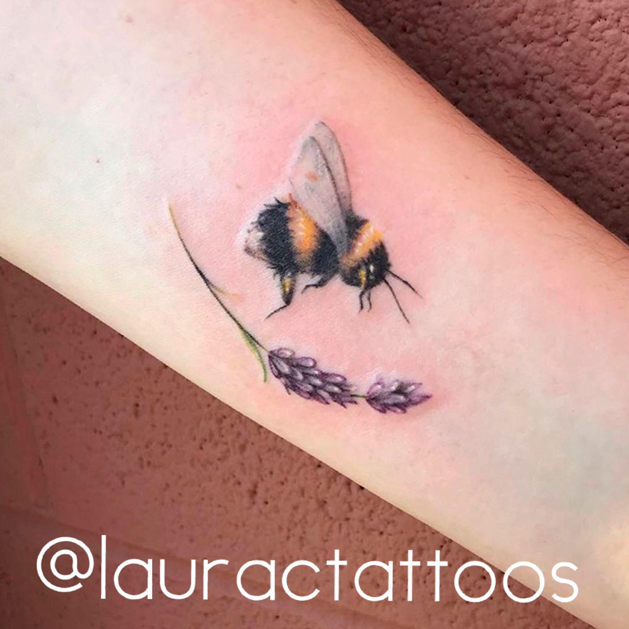 The cutest little bee tattoo